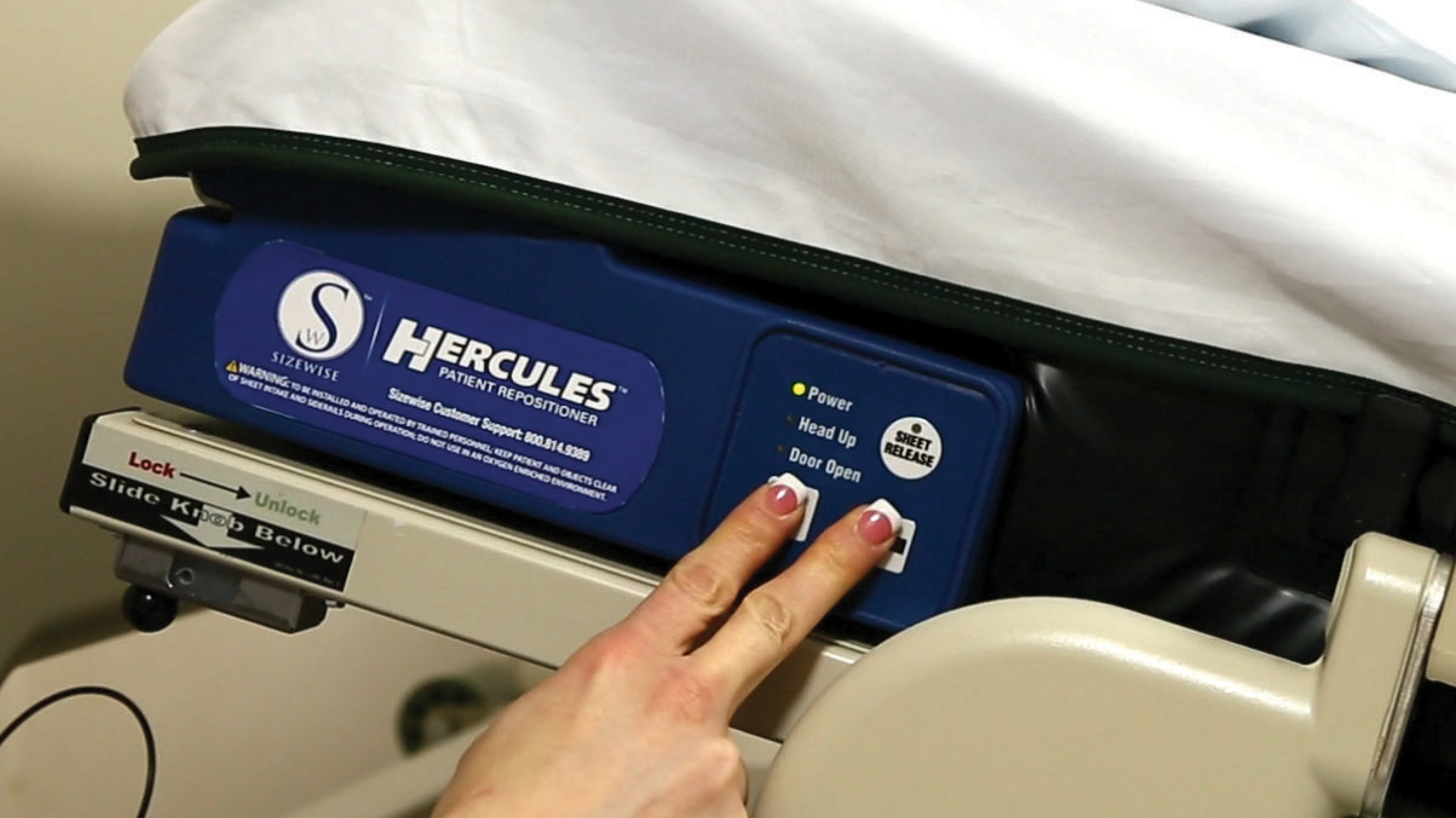 Caregiver Using Two Fingers For Hercules Control Panel