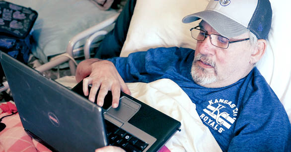 Patient Mike With Laptop On Sizewise Alternate Air Mattress