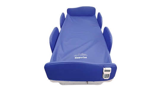 Behavioral Health Bed with blue seizure pads on head, side, and foot boards